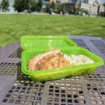 a lunch in a green plastic tuppy
