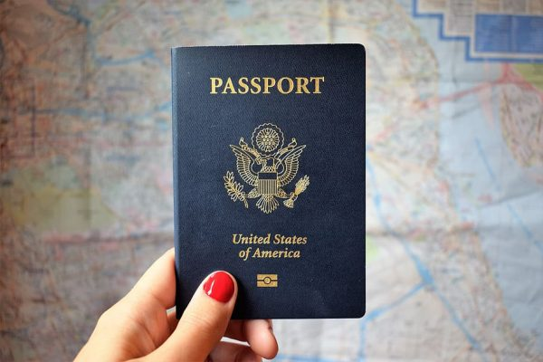 hand holding up a passport