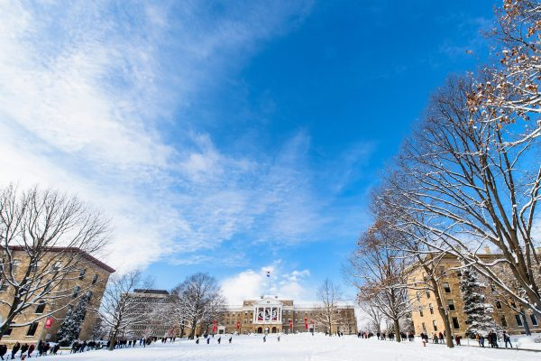 Looking up Bascom hill that is snow covered on a bright blue wintery day.