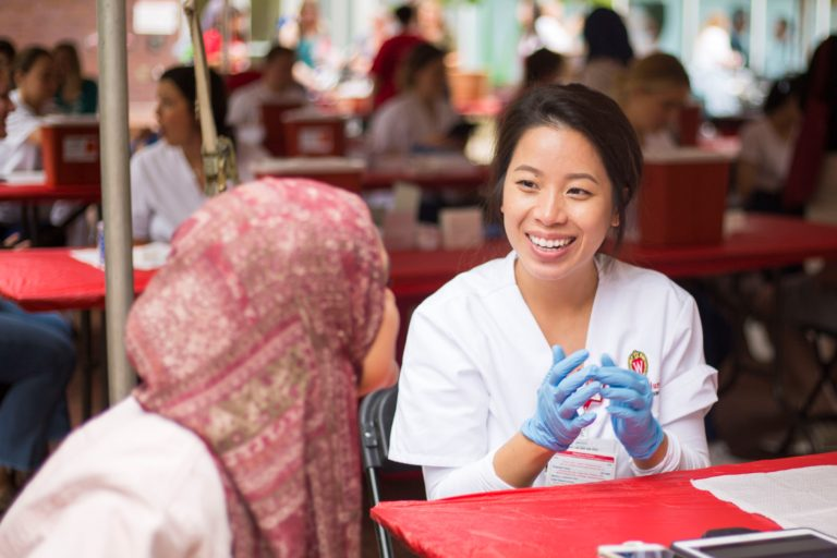 Nurse smiling at patient before giving flu shot