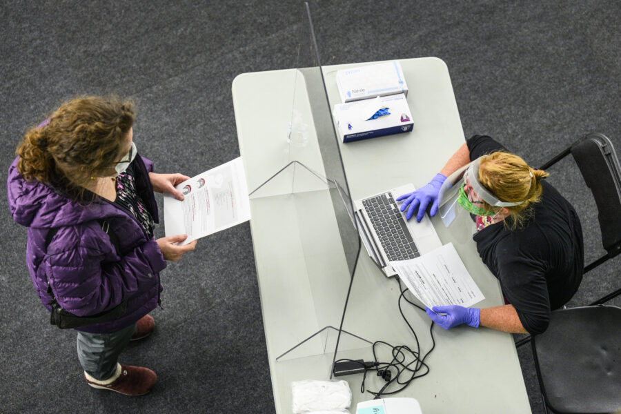 a person checks in to be tested