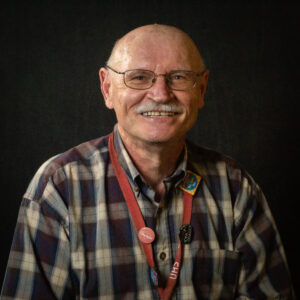 Felix Savino wearing a plaid shirt and UHS lanyard