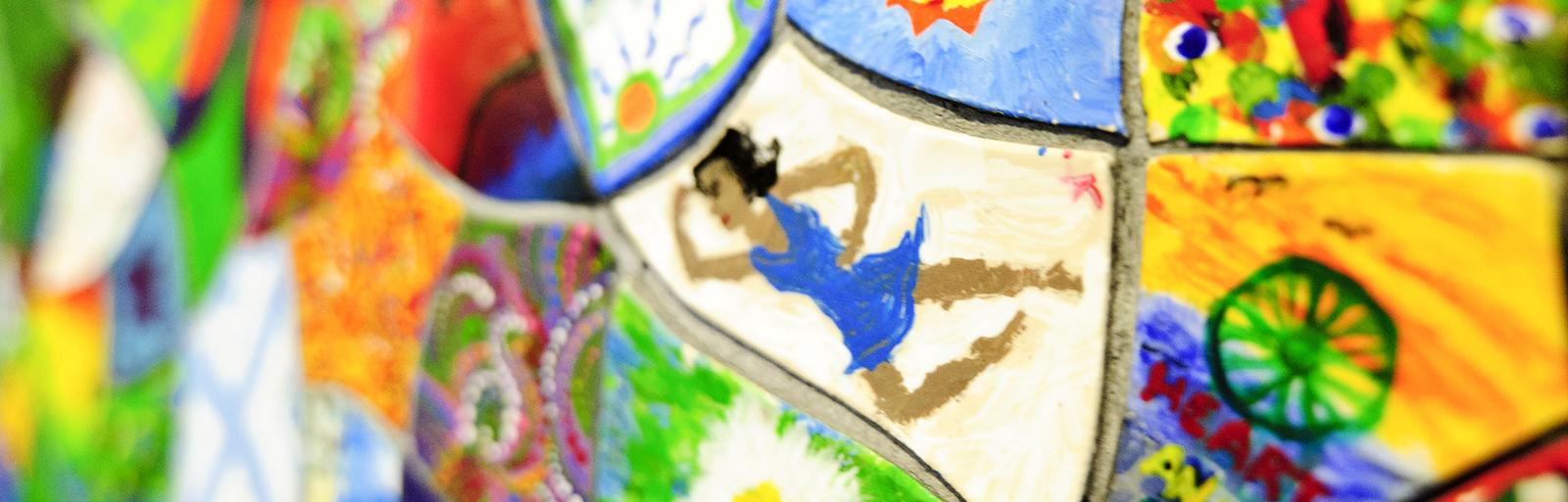 """As seen on April 4, 2012, a close-up detail of painted tiles that make up the """"Walk This Way"""" mural just outside of the Craftshop at the Memorial Union at the University of Wisconsin-Madison.(Photo by Bryce Richter / UW-Madison)"""