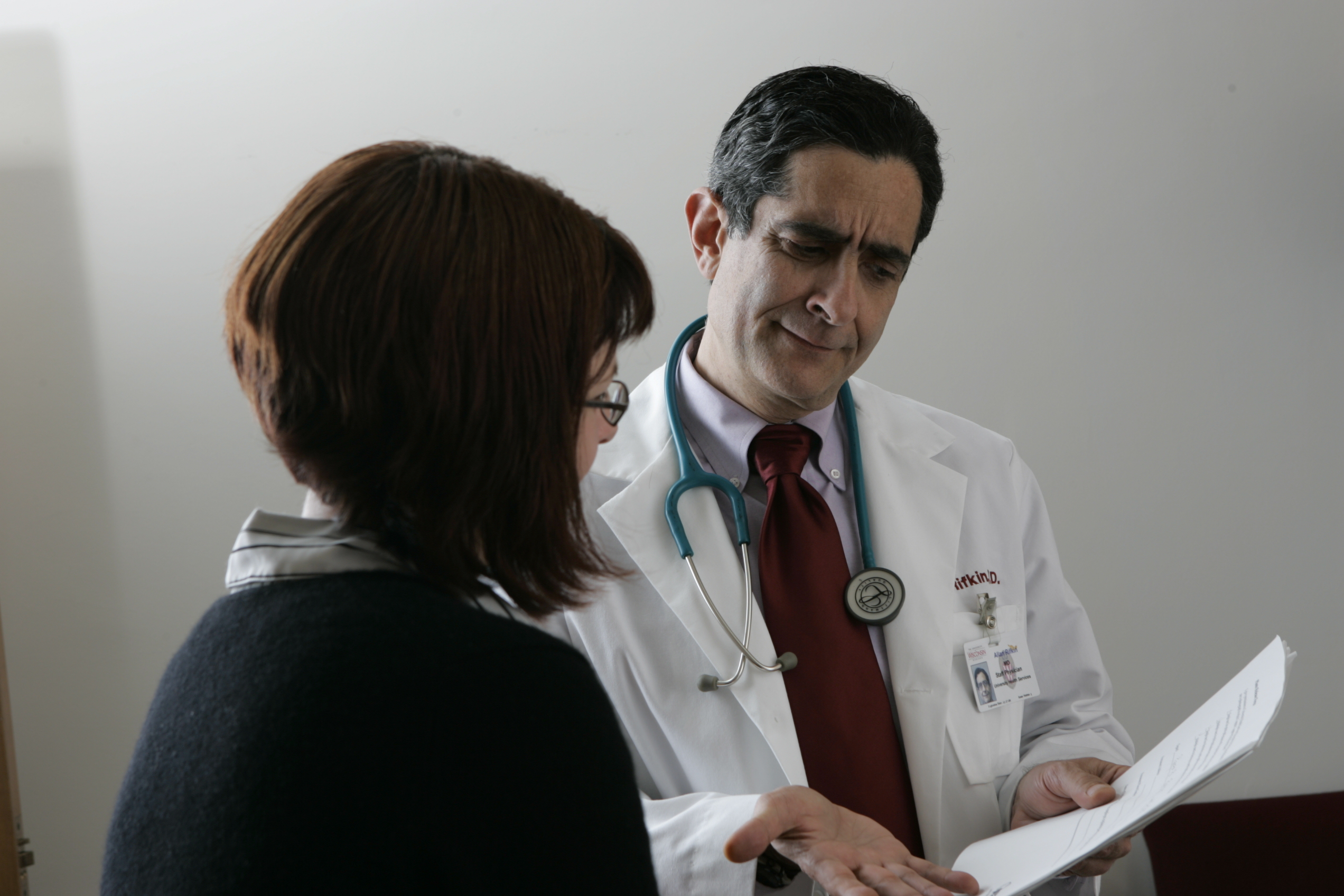 Image of a doctor speaking with a patient.